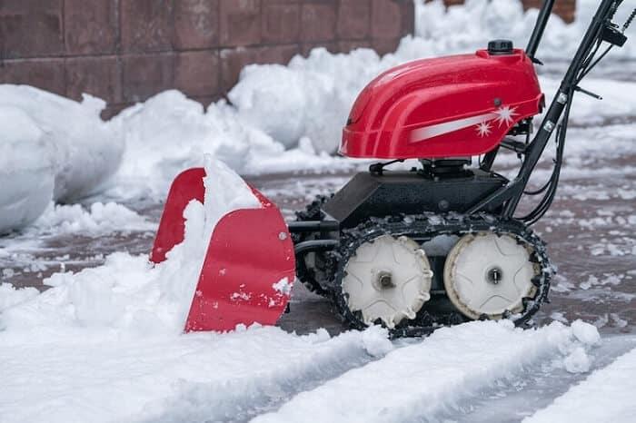 Hand Schneepflug mit Benzin Motor